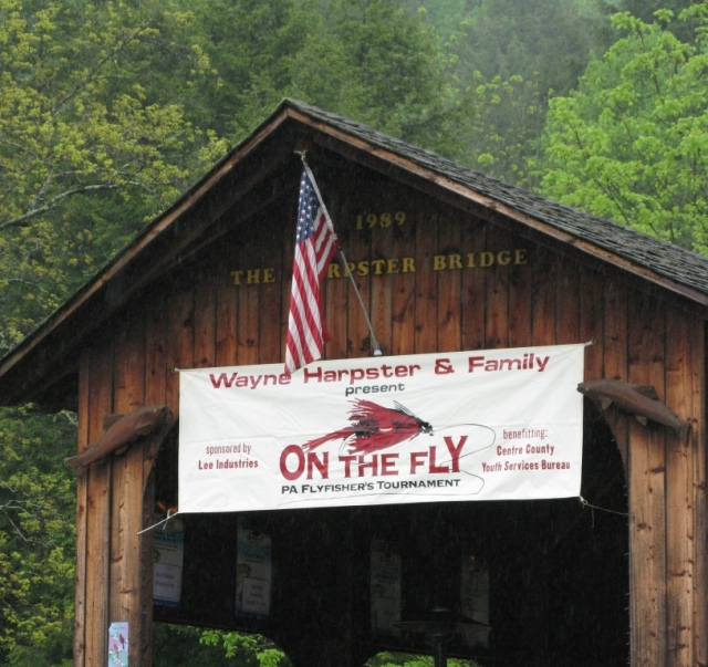 On The Fly sign at the Harpster covered bridge on Spruce Creek.