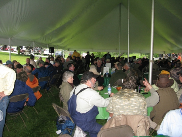 Attendees enjoy the evening dinner under the main tent.