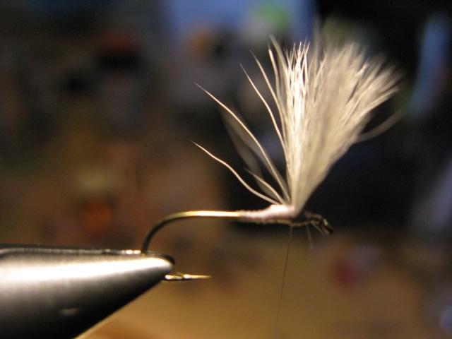 #12 standard dry fly hook, the wing is attached but not yet posted around the base.