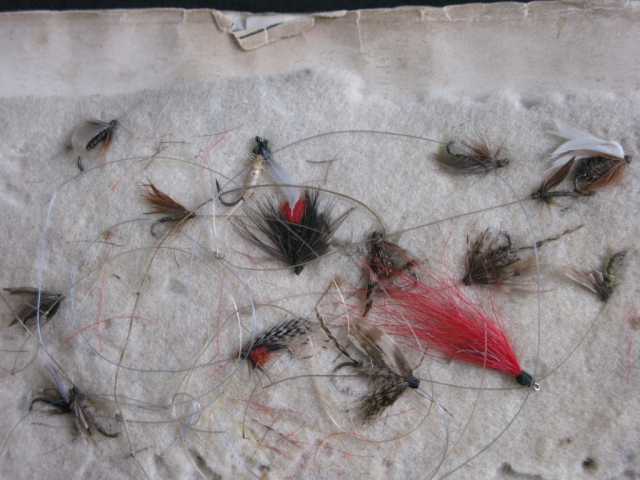 Antique snelled wet flies, on the interior bound-in felt page.