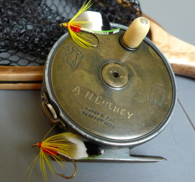 A. N. Cheney's Hardy Perfect reel, with two Cheney Bass Flies, tied by Don Bastian. Photo by Howard Weinberg.