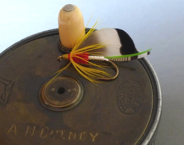 Cheney's Hardy perfect reel with Cheney Bass Fly tied by Don Bastian.