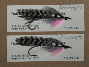 A pair of the Pink Lady streamer pattern, originated by Carrie Stevens. This was the final fly tied of her career, on the day in December 1953, when she sold her business to H. Wendell Folkins of New Hampshire.