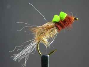This is the gingeerr colored veersion of Bastian's Floating Caddis / Mayfly Emerger, this KILLS on Speing Creeek and any stream where the sulfurs, Ephemerella rotunda exist.