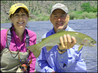 Sue Ukena and Orvis 2014 Guide of the Year, Tim Linehan, with a Missouri River rainbow that fell to Bastian's Floating Caddis Emerger.